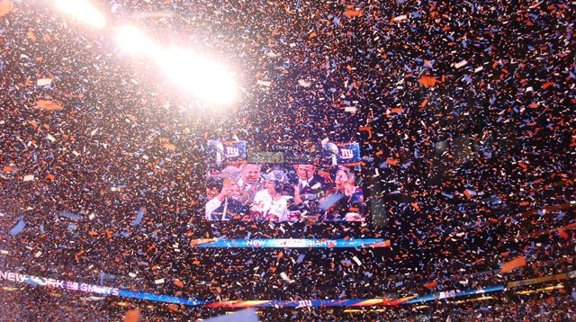 Eli on the Screen as Confetti Rains Down