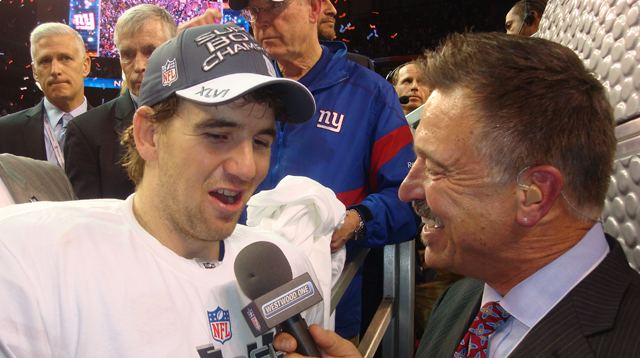Mark Malone with Eli Manning