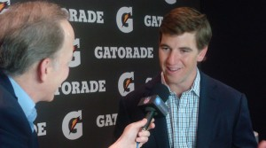 Eli Manning is interviewed by Jim Gray at Super Bowl XLVII.