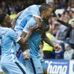 Manchester City's Aleksandar Kolarov, center, celebrates with teammates after scoring during the English Premier League soccer match between Everton and Manchester City at Goodison Park Stadium, Liverpool, England, Sunday Aug. 23, 2015. (AP Photo/Jon Super)
