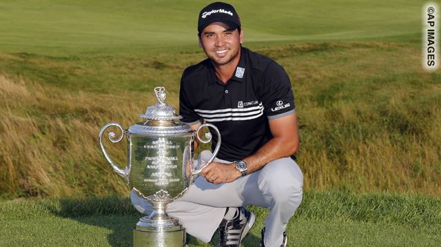 Jason Day, of Australia, poses with the Wanamaker Trophy after winning the PGA Championship golf tournament Sunday, Aug. 16, 2015, at Whistling Straits in Haven, Wis. (AP Photo/Julio Cortez)