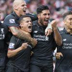 Liverpool's Philippe Coutinho, lower centre left, celebrates with teammates after scoring during the English Premier League soccer match between Stoke and Liverpool at the Britannia Stadium, Stoke, England, Sunday Aug. 9, 2015. (AP Photo/Jon Super)