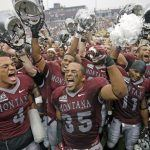 Montana's Chris Parker (4) and Kendrick Van Ackeren (35) celebrate with teammates after their NCAA college football game against North Dakota State, Saturday, Aug. 29, 2015, in Missoula, Mont. Montana won 38-35. (AP Photo/Rick Bowmer)