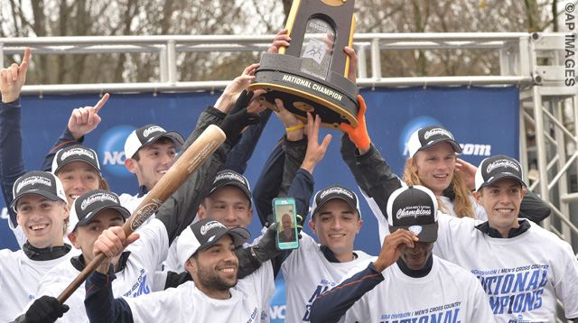 Members of the Syracuse cross country team hold up the team trophy for their victory in the men's NCAA Cross Country National Championship, Saturday, Nov. 21, 2015, in Louisville, Ky. (AP Photo/Timothy D. Easley)