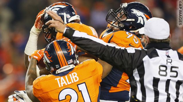 Denver Broncos outside linebacker DeMarcus Ware, rear, celebrates his fumble recovery for the win with Aqib Talib (21) and Derek Wolfe (95) an NFL football game against the Cincinnati Bengals, Monday, Dec. 28, 2015, in Denver. The Broncos won 20-17 in overtime. (AP Photo/Joe Mahoney)