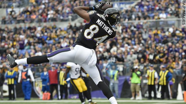 Baltimore Ravens wide receiver Chris Matthews (84) pulls in a touchdown pass during the first half of an NFL football game against the Pittsburgh Steelers in Baltimore, Sunday, Dec. 27, 2015. (AP Photo/Nick Wass)