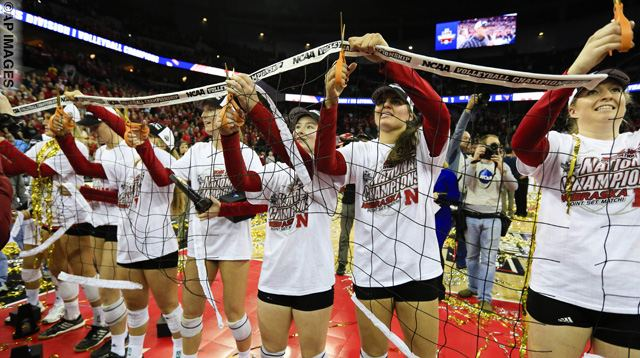 Nebraska players cut the net after winning the NCAA women's volleyball tournament finals in Omaha, Neb., Saturday, Dec. 19, 2015. Nebraska won the championship after defeating Texas in three sets. (AP Photo/Nati Harnik)