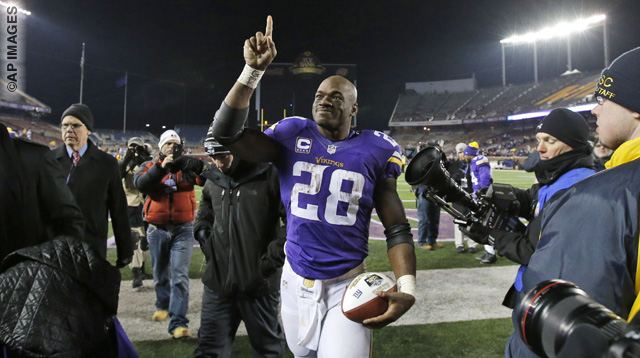 Minnesota Vikings running back Adrian Peterson (28) points to the fans as he comes off the field after an NFL football game against the New York Giants, Sunday, Dec. 27, 2015, in Minneapolis. The Vikings won 49-17. (AP Photo/Ann Heisenfelt)