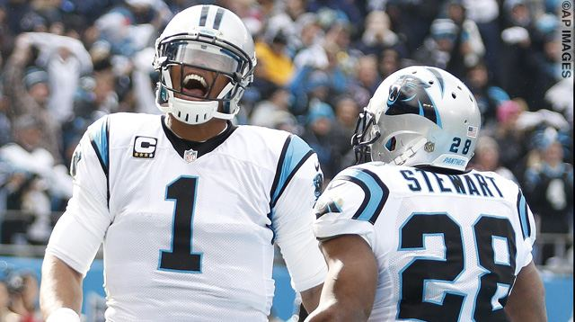 Carolina Panthers running back Jonathan Stewart (28) celebrates his touchdown with Carolina Panthers quarterback Cam Newton (1) against the Seattle Seahawks during the first half of an NFL divisional playoff football game, Sunday, Jan. 17, 2016, in Charlotte, N.C. (AP Photo/Bob Leverone)