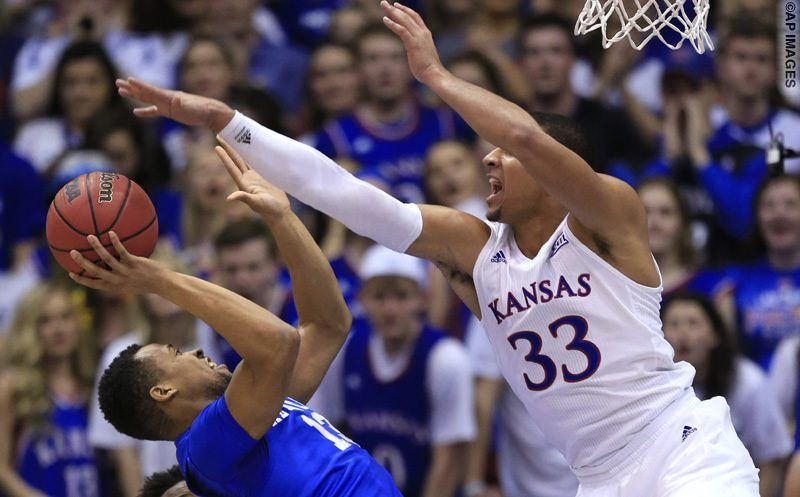 Kentucky guard Isaiah Briscoe (13) shoots against Kansas forward Landen Lucas (33) during the first half of an NCAA college basketball game in Lawrence, Kan., Saturday, Jan. 30, 2016. (AP Photo/Orlin Wagner)