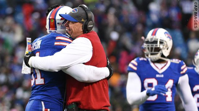 Buffalo Bills head coach Rex Ryan celebrates with after Manny Lawson, left, as teammates Mario Williams (94) and Corey Graham (20) watch after Lawson intercepted a pass during the second half of an NFL football game against the New York Jets Sunday, Jan. 3, 2016, in Orchard Park, N.Y. (AP Photo/Gary Wiepert)