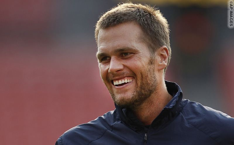 New England Patriots quarterback Tom Brady smiles during warm ups before an NFL football preseason game against the Washington Redskins in Landover, Md., Thursday, Aug. 7, 2014. (AP Photo/Connor Radnovich)