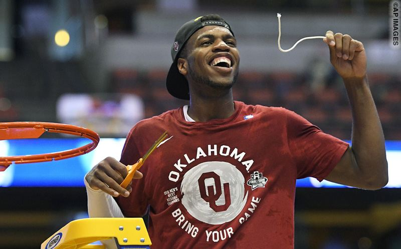 Oklahoma guard Buddy Hield cuts down the net after their win against Oregon during an NCAA college basketball game in the regional finals of the NCAA Tournament, Saturday, March 26, 2016, in Anaheim, Calif. (AP Photo/Mark J. Terrill)