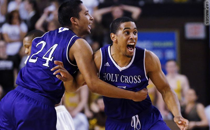 Holy Cross forward Eric Green (24) and guard Cullen Hamilton celebrate after defeating Lehigh 59-56 in the NCAA college basketball Patriot League Championship game at Lehigh in Bethlehem, Pa., Wednesday, March 9, 2016. (AP Photo/Rich Schultz)
