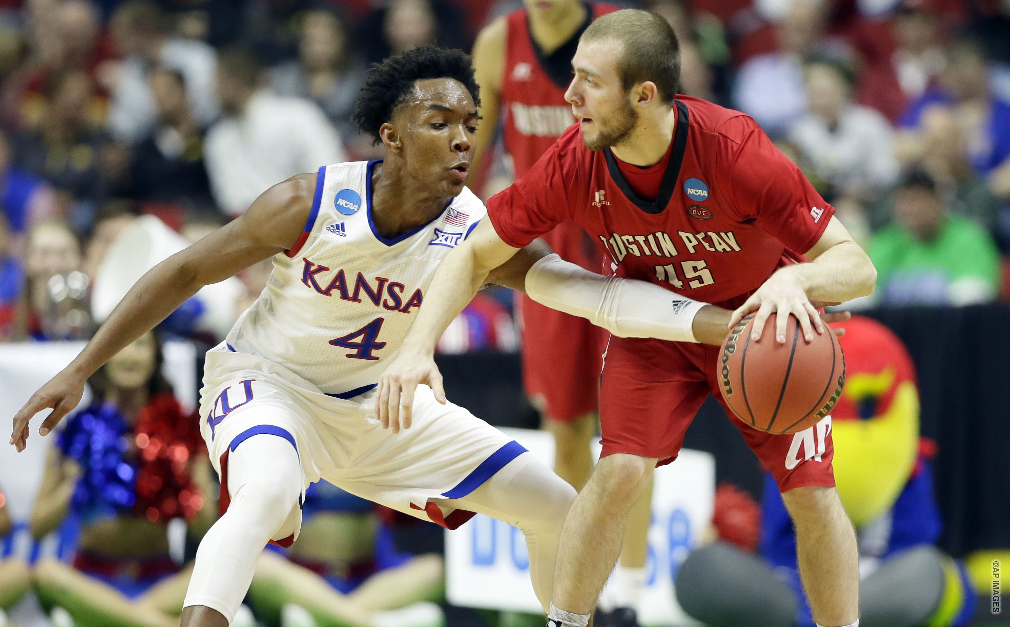 Kansas guard Devonte' Graham, left, tries to steal the ball from Austin Peay guard Zach Glotta during the first half of a first-round men's college basketball game in the NCAA Tournament, Thursday, March 17, 2016, in Des Moines, Iowa. (AP Photo/Charlie Neibergall)