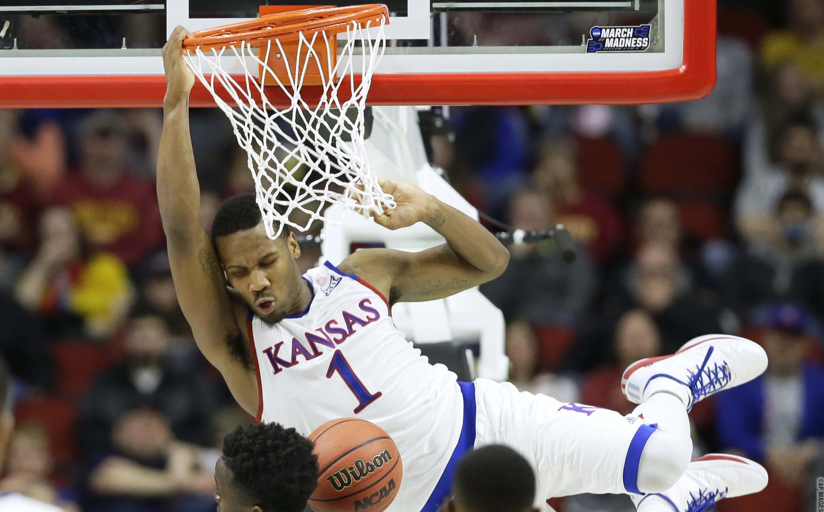 Kansas guard Wayne Selden Jr. (1) dunks during the second half of a second-round men's college basketball game against Connecticut in the NCAA Tournament, Saturday, March 19, 2016, in Des Moines, Iowa. Kansas won 73-61. (AP Photo/Charlie Neibergall)