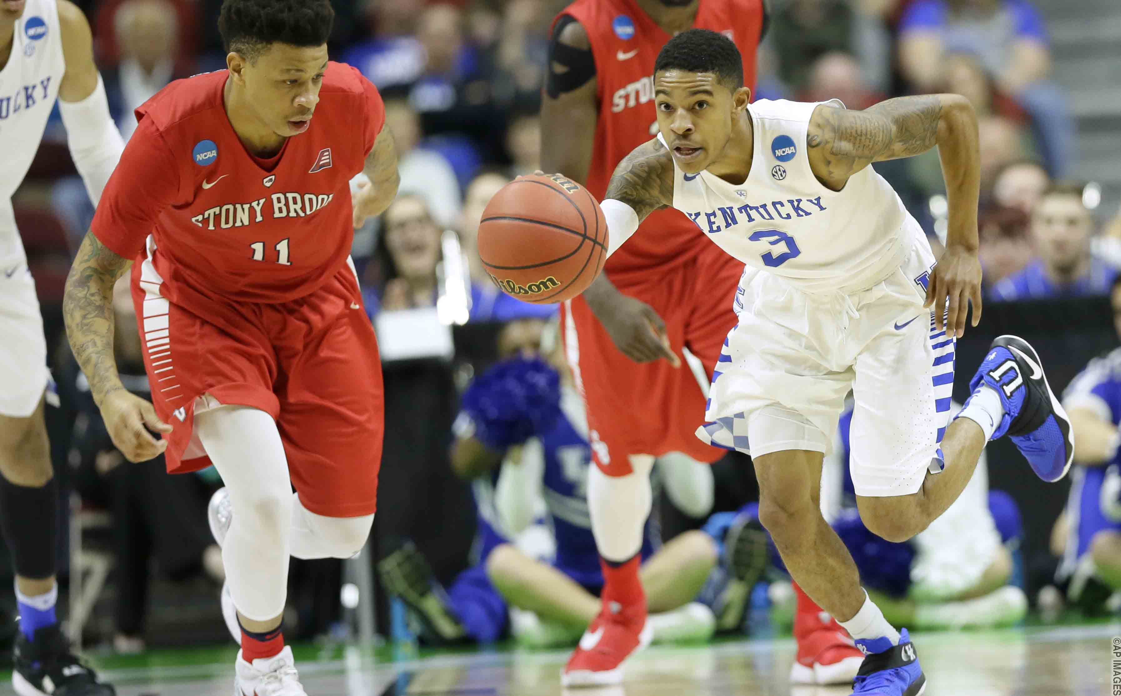 Kentucky guard Tyler Ulis drives upcourt past Stony Brook forward Rayshaun McGrew, left, during the first half of a first-round men's college basketball game in the NCAA Tournament, Thursday, March 17, 2016, in Des Moines, Iowa. (AP Photo/Charlie Neibergall)