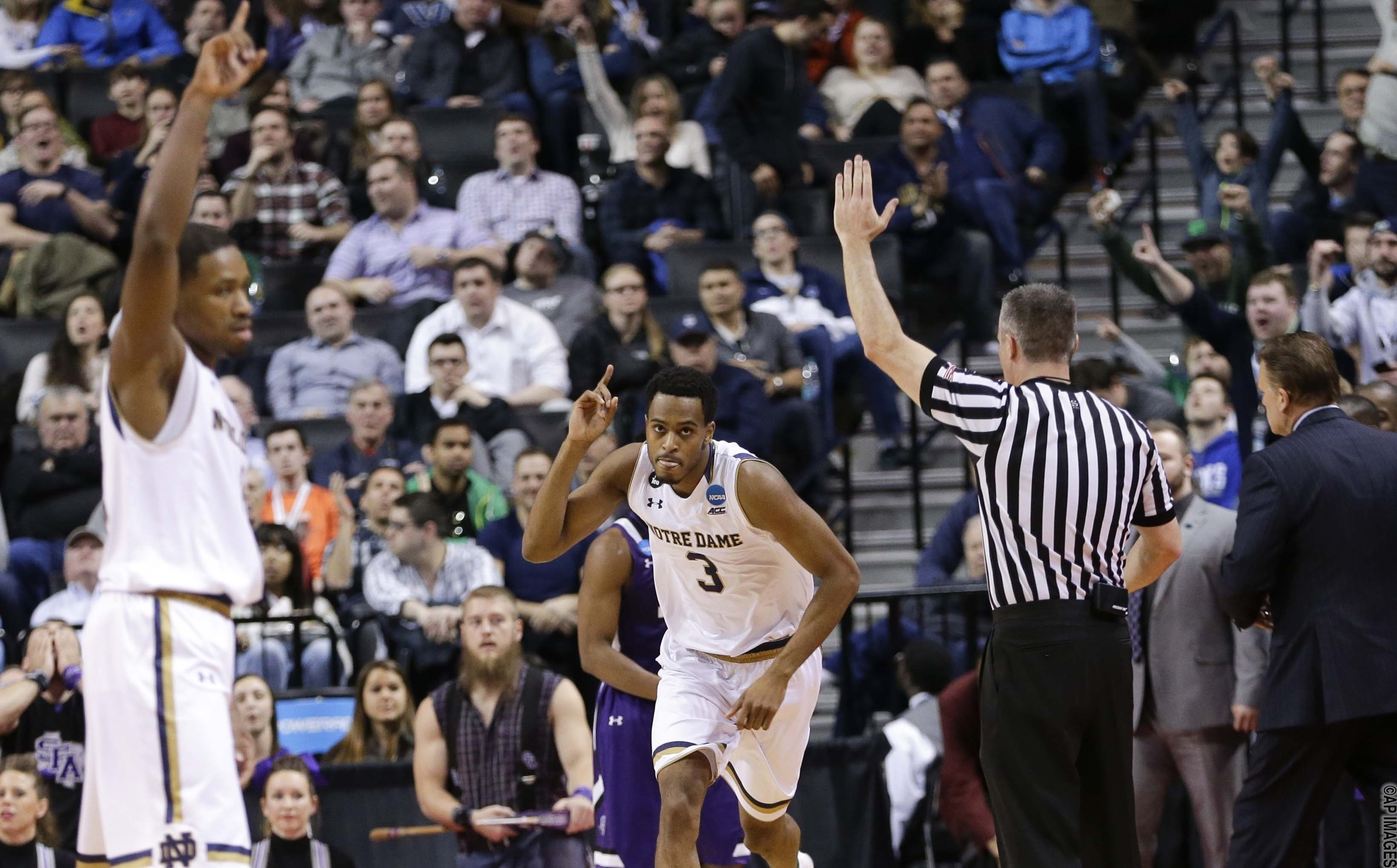 Notre Dame's V.J. Beachem (3) celebrates with teammate Demetrius Jackson, left, after making a 3-point basket during the first half of a second-round men's college basketball game against Stephen F. Austin in the NCAA Tournament, Sunday, March 20, 2016, in New York. (AP Photo/Frank Franklin II)