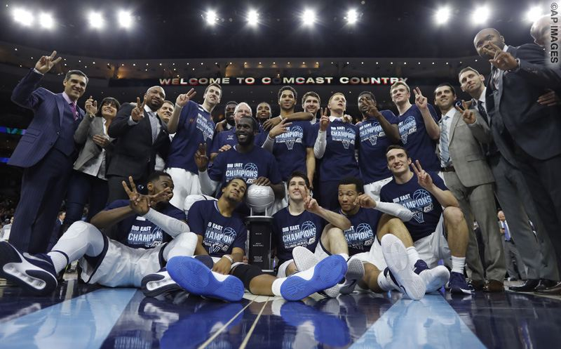 Villanova players and staff pose with the Big East conference regular season champion trophy after an NCAA college basketball game against Georgetown, Saturday, March 5, 2016, in Philadelphia. (AP Photo/Matt Slocum)