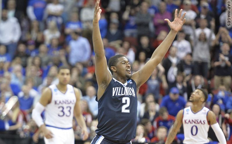 Villanova forward Kris Jenkins (2) celebrates after a regional final men's college basketball game in the NCAA Tournament against Kansas, Saturday, March 26, 2016, in Louisville, Ky. Villanova won 64-59. (AP Photo/Timothy D. Easley)