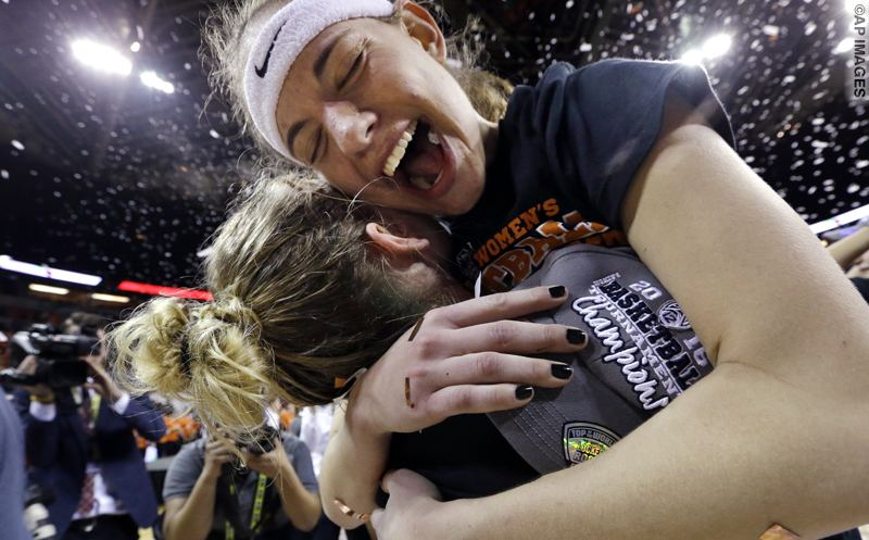 Oregon State's Sydney Wiese, right, embraces Jamie Weisner as confetti falls around them after the team was awarded the Pac-12 Conference tournament championship trophy after beating UCLA in an NCAA college basketball game, Sunday, March 6, 2016, in Seattle. Oregon State won 69-57. (AP Photo/Elaine Thompson)