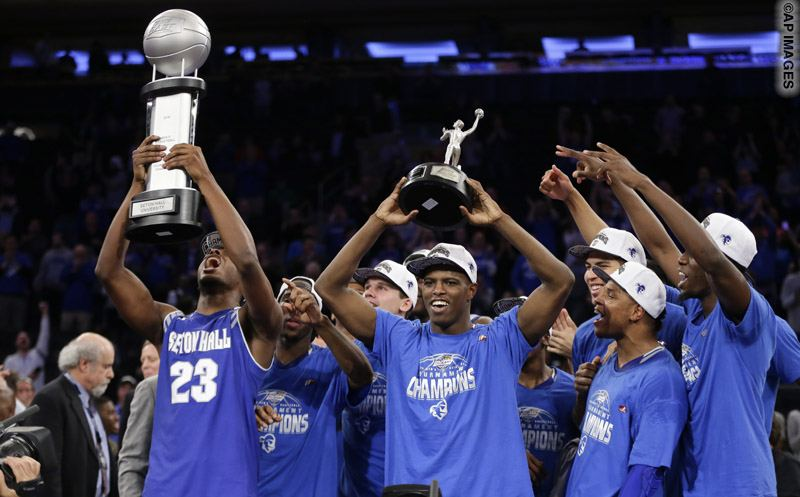 Seton Hall's Isaiah Whitehead, center, celebrates with teammates while holding the poses for photos with the Most Outstanding Player trophy after an NCAA college basketball game during the Big East men's tournament against Villanova Saturday, March 12, 2016, in New York. Seton Hall won 69-67. (AP Photo/Frank Franklin II)