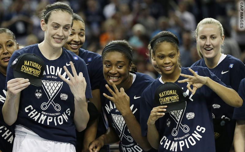 Connecticut forward Breanna Stewart, left, and other players pose for photographers after the second half of the NCAA women's Final Four tournament college basketball championship game against Notre Dame, Tuesday, April 7, 2015, in Tampa, Fla. Connecticut won 63-53. (AP Photo/John Raoux)