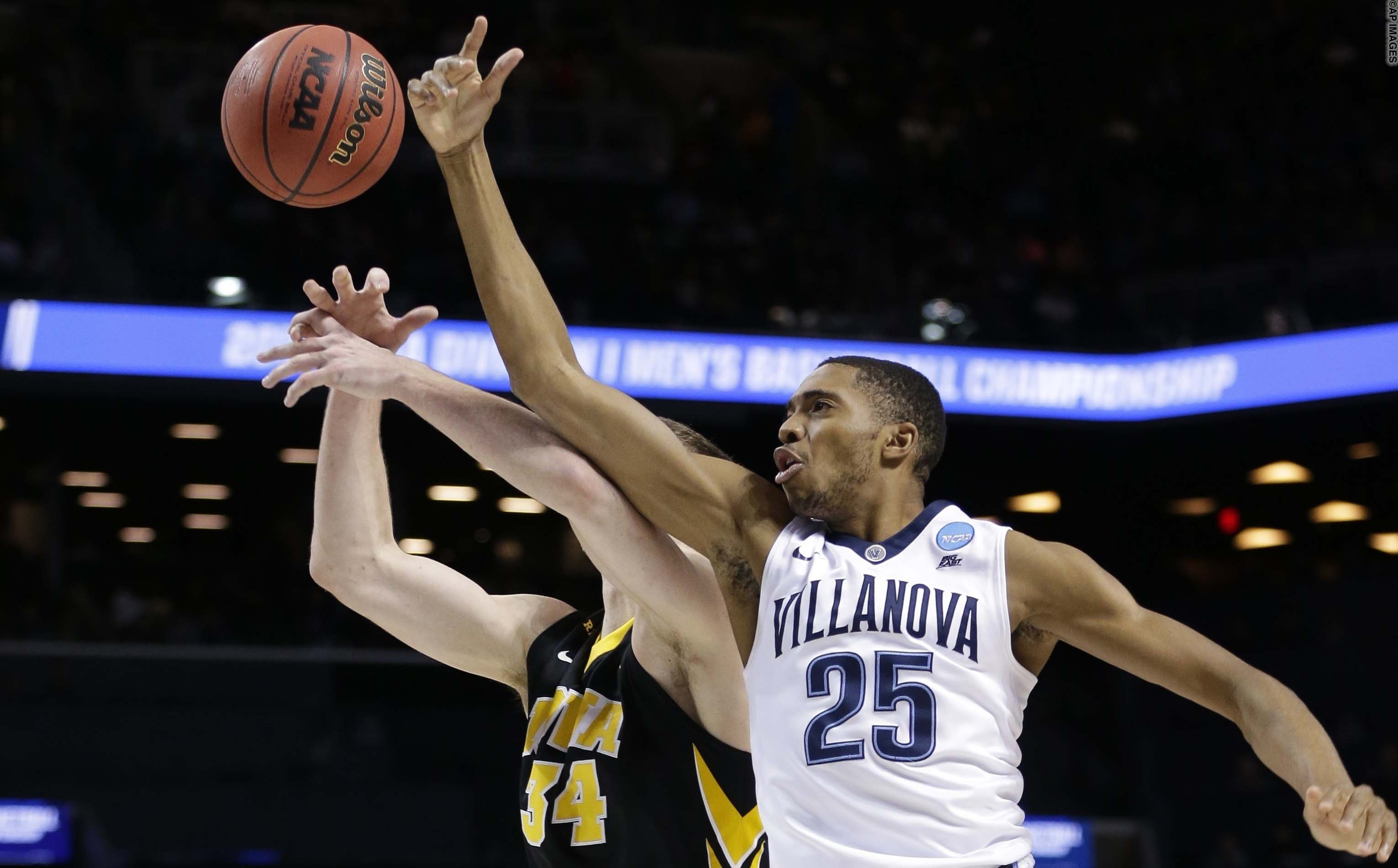 Villanova's Mikal Bridges (25) knocks the ball away from Iowa's Adam Woodbury (34) during the first half of a second-round men's college basketball game in the NCAA Tournament, Sunday, March 20, 2016, in New York. (AP Photo/Frank Franklin II)
