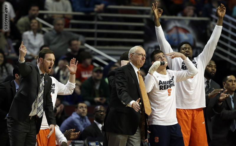 Syracuse bench react to a three point basket during the second half of a college basketball game against Virginia in the regional finals of the NCAA Tournament, Sunday, March 27, 2016, in Chicago. (AP Photo/Nam Y. Huh)