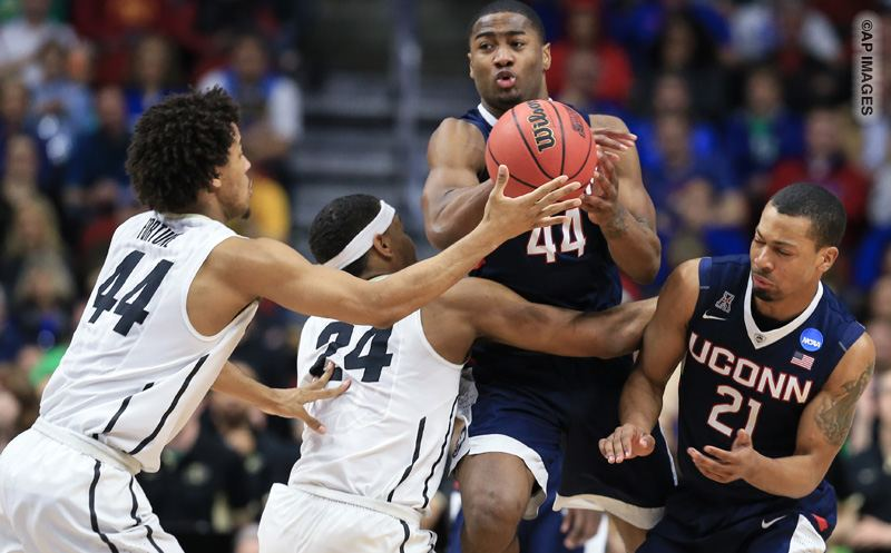 Connecticut's Rodney Purvis (44) is fouled by Colorado's George King (24) with Colorado's Josh Fortune (44) and Connecticut's Omar Calhoun (21) flanking them, during a first-round men's college basketball game in the NCAA Tournament in Des Moines, Iowa, Thursday, March 17, 2016. Connecticut won 74-67. (AP Photo/Nati Harnik)
