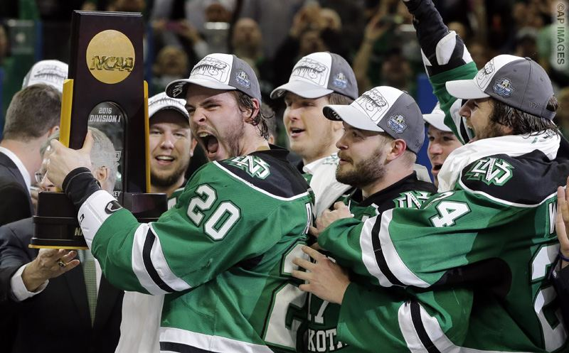 North Dakota defenseman Gage Ausmus (20) celebrates after the team defeated Quinnipiac, 5-1, during an NCAA Frozen Four championship college hockey game Saturday, April 9, 2016, in Tampa, Fla. (AP Photo/Chris O'Meara)