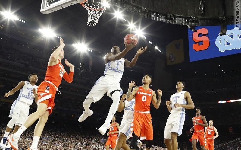 North Carolina forward Theo Pinson (1) shoots against Syracuse forward Tyler Lydon (20) during the first half of the NCAA Final Four tournament college basketball semifinal game Saturday, April 2, 2016, in Houston. (AP Photo/Eric Gay)