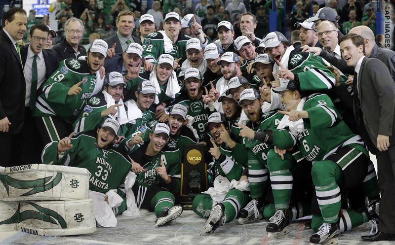 North Dakota celebrates their 5-1 win over Quinnipiac during an NCAA Frozen Four championship college hockey game Saturday, April 9, 2016, in Tampa, Fla. (AP Photo/Chris O'Meara)
