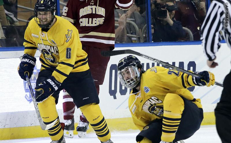 Quinnipiac defenseman Kevin McKernan (27, right) celebrates his goal against Boston College during the first period of an NCAA Frozen Four semifinal college hockey game Thursday, April 7, 2016, in Tampa, Fla. Looking on is Devon Toews (6). (AP Photo/Chris O'Meara)
