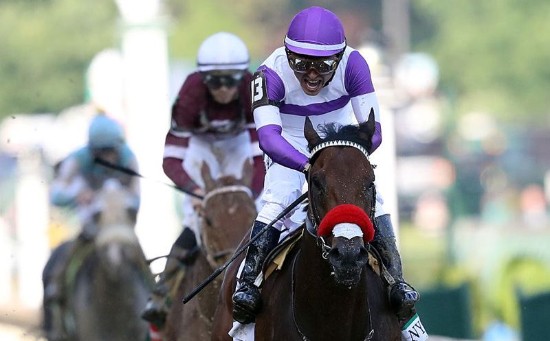 LOUISVILLE, KY - MAY 07:  Nyquist #13, ridden by Mario Gutierrez, crosses the finish line during the 142nd running of the Kentucky Derby at Churchill Downs on May 07, 2016 in Louisville, Kentucky.  (Photo by Rob Carr/Getty Images)