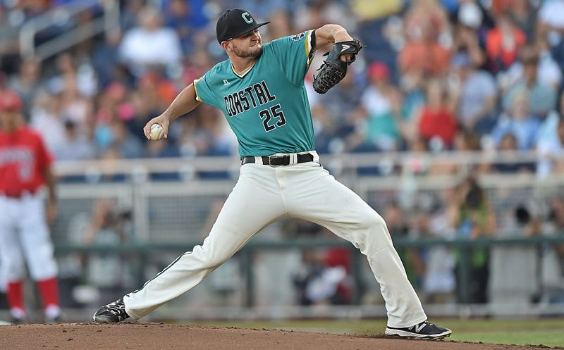 OMAHA, NE - JUNE 28:  Pitcher Mike Morrison #25 of the Coastal Carolina Chanticleers delivers a pitch against the Arizona Wildcats in the first inning during game two of the College World Series Championship Series on June 28, 2016 at TD Ameritrade Park in Omaha, Nebraska.  (Photo by Peter Aiken/Getty Images)