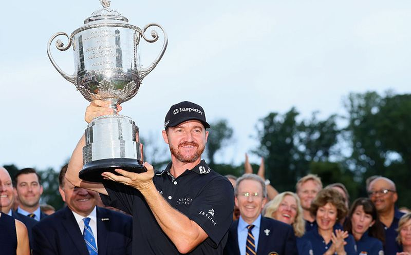 SPRINGFIELD, NJ - JULY 31:  Jimmy Walker of the United States celebrates with the Wanamaker Trophy after winning the 2016 PGA Championship at Baltusrol Golf Club on July 31, 2016 in Springfield, New Jersey.  (Photo by Andrew Redington/Getty Images)