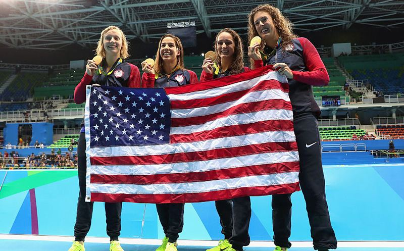 RIO DE JANEIRO, BRAZIL - AUGUST 10:  Gold medalists Allison Schmitt, Leah Smith, Maya Dirado and Katie Ledecky of the United States pose during the medal ceremony for the Women's 4 x 200m Freestyle Relay Final on Day 5 of the Rio 2016 Olympic Games at the Olympic Aquatics Stadium on August 10, 2016 in Rio de Janeiro, Brazil.  (Photo by Tom Pennington/Getty Images)