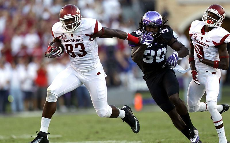 FORT WORTH, TX - SEPTEMBER 10:  Jeremy Sprinkle #83 of the Arkansas Razorbacks runs the ball past Denzel Johnson #30 of the TCU Horned Frogs in the first half at Amon G. Carter Stadium on September 10, 2016 in Fort Worth, Texas.  (Photo by Ronald Martinez/Getty Images)