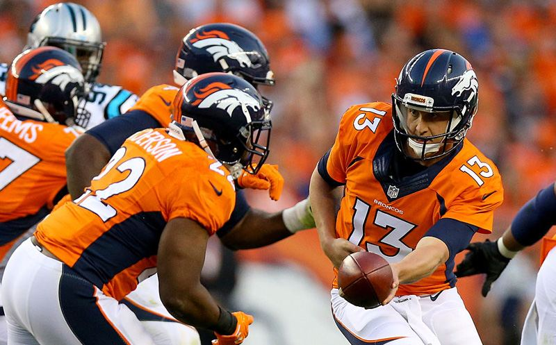 DENVER, CO - SEPTEMBER 08:  Quarterback Trevor Siemian #13 of the Denver Broncos hands the ball off to running back C.J. Anderson #22 against the Carolina Panthers at Sports Authority Field at Mile High on September 8, 2016 in Denver, Colorado.  (Photo by Justin Edmonds/Getty Images)