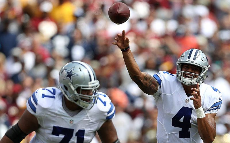 LANDOVER, MD - SEPTEMBER 18: Quarterback Dak Prescott #4 of the Dallas Cowboys passes while teammate offensive guard La'el Collins #71 blocks against the Washington Redskins in the first quarter at FedExField on September 18, 2016 in Landover, Maryland. (Photo by Patrick Smith/Getty Images)