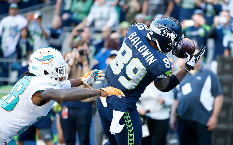 SEATTLE, WA - SEPTEMBER 11:  Wide receiver Doug Baldwin #89 of the Seattle Seahawks brings in a touchdown pass against the defense of cornerback Bobby McCain #28 of the Miami Dolphins in the fourth quarter at CenturyLink Field on September 11, 2016 in Seattle, Washington.  (Photo by Otto Greule Jr/Getty Images)