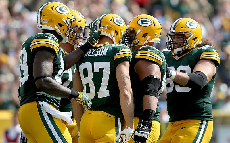 GREEN BAY, WI - SEPTEMBER 25:  Jordy Nelson #87 of the Green Bay Packers is congratulated by teammates after scoring a touchdown in the first quarter against the Detroit Lions at Lambeau Field on September 25, 2016 in Green Bay, Wisconsin. (Photo by Dylan Buell/Getty Images)