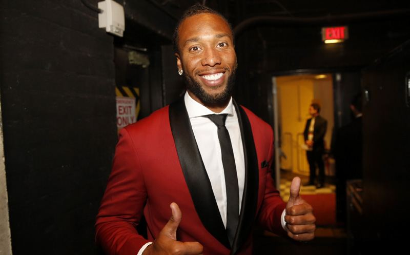 Larry Fitzgerald, of the Arizona Cardinals, is seen with the awards the inaugural Art Rooney sportsmanship award at the 4th annual NFL Honors at the Phoenix Convention Center Symphony Hall on Saturday, Jan. 1, 2015. (Photo by Colin Young-Wolff/Invision for NFL/AP Images)