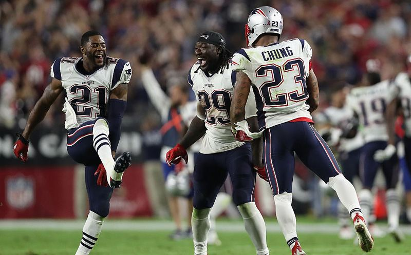 GLENDALE, AZ - SEPTEMBER 11:   (L-R) Malcolm Butler #21,  LeGarrette Blount #29 and Patrick Chung #23 of the New England Patriots celebrate after defeating the Arizona Cardinals 23-21 in the NFL game at the University of Phoenix Stadium on September 11, 2016 in Glendale, Arizona.  (Photo by Christian Petersen/Getty Images)