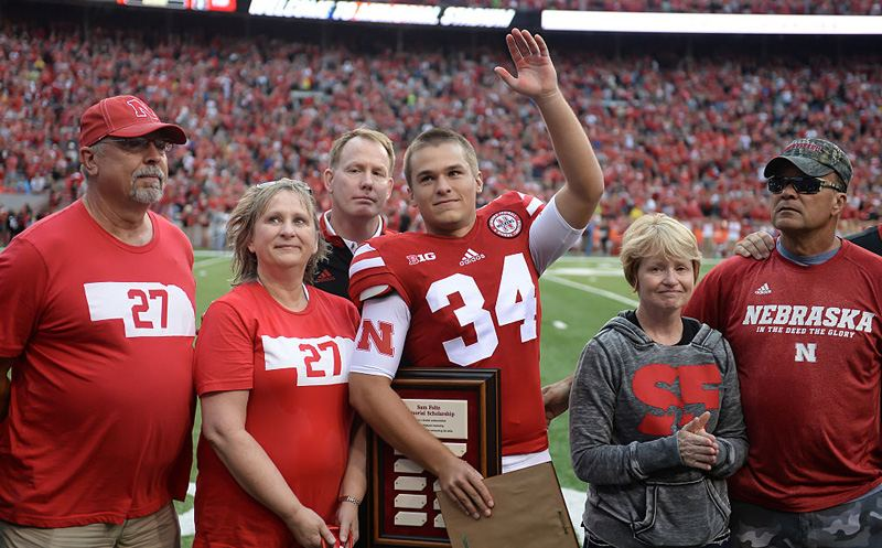 LINCOLN, NE - SEPTEMBER 03: Place kicker Drew Brown #34 of the Nebraska Cornhuskers accepts a scholarship named for deceased punter Sam Foltz in a presentation before the game against the Fresno State Bulldogs.  Also pictured, left to right, are Hobert and Terri Brown, Athletic Director Shawn Eichorst, and Jill and Gerald Foltz at Memorial Stadium on September 3, 2016 in Lincoln, Nebraska. Nebraska defeated Fresno State 43-10.  (Photo by Steven Branscombe/Getty Images)