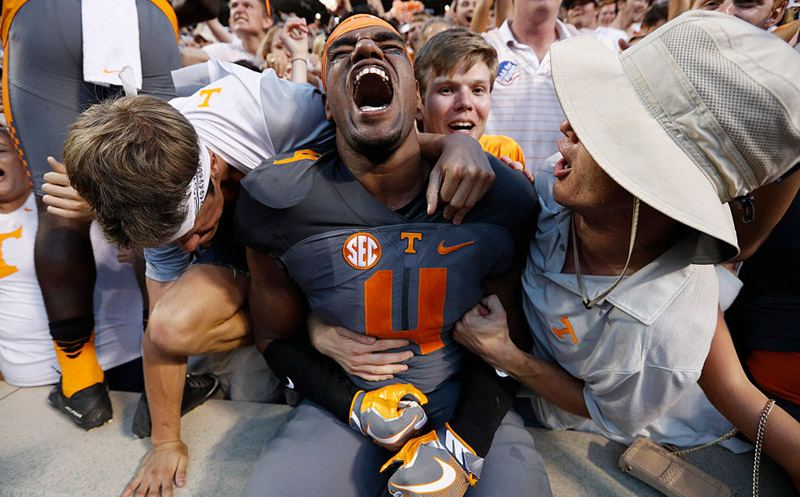 KNOXVILLE, TN - SEPTEMBER 24: LaTroy Lewis #4 of the Tennessee Volunteers celebrates with fans after the Vols defeated the Florida Gators 38-28 at Neyland Stadium on September 24, 2016 in Knoxville, Tennessee. (Photo by Joe Robbins/Getty Images)