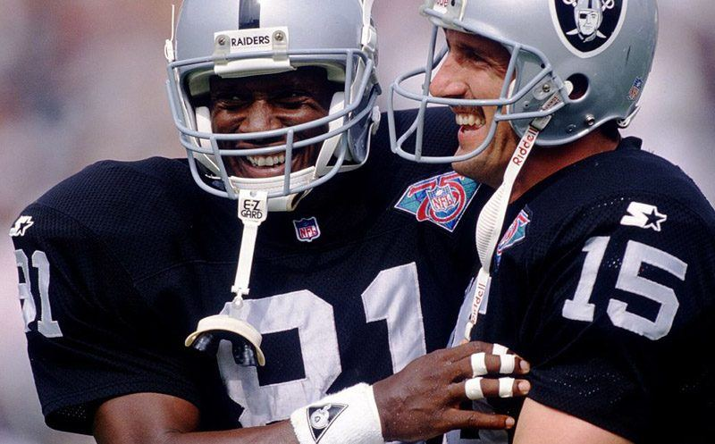 23 OCT 1994:  WIDE RECEIVER TIM BROWN, LEFT, AND QUARTERBACK JEFF HOSTETLER OF THE LOS ANGELES RAIDERS CELEBRATE AFTER COMBINING FOR A SECOND QUARTER TOUCHDOWN AS THE RAIDERS DEFEATED THE ATLANTA FALCONS,  30-17 AT THE COLISEUM IN LOS ANGELES, CALIFORNIA.