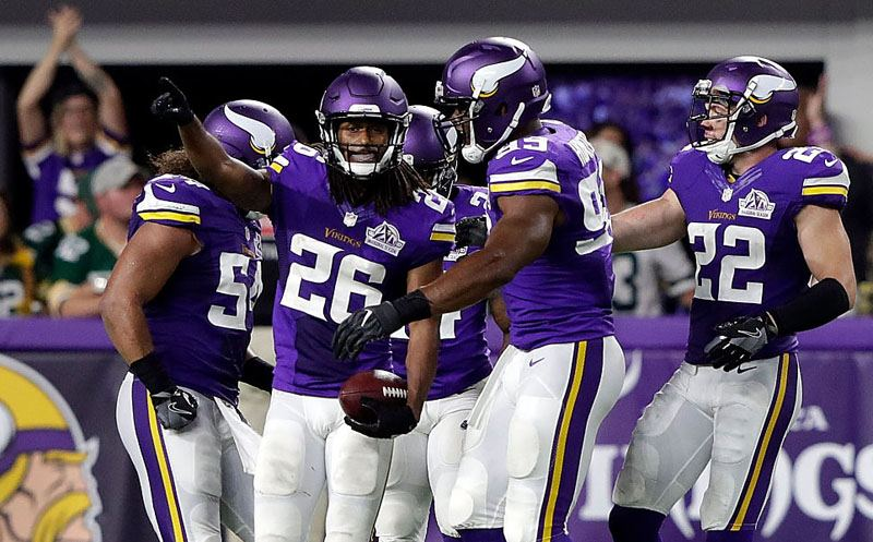 MINNEAPOLIS, MN - SEPTEMBER 18:  Cornerback Trae Waynes #26 of the Minnesota Vikings is congratulated by teammates after making an interception late in the fourth quarter during the game against the Green Bay Packers on September 18, 2016 in Minneapolis, Minnesota.  (Photo by Jamie Squire/Getty Images)