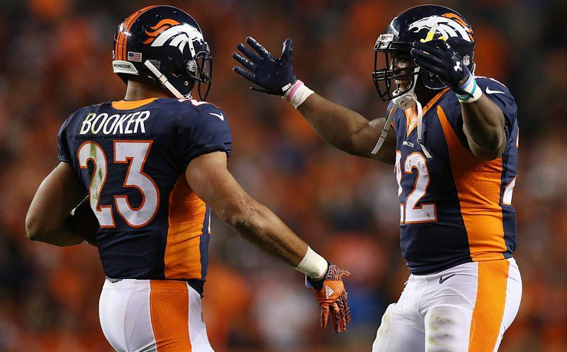 DENVER, CO - OCTOBER 24:  Running back Devontae Booker #23 and running back C.J. Anderson #22 of the Denver Broncos celebrate a score in the second half of the game against the Houston Texans at Sports Authority Field at Mile High on October 24, 2016 in Denver, Colorado. (Photo by Justin Edmonds/Getty Images)